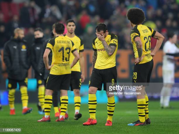 Paco Alcácer and Axel Witsel of Dortmund look dejected after the Bundesliga match between FC Augsburg and Borussia Dortmund at WWKArena on March 01...