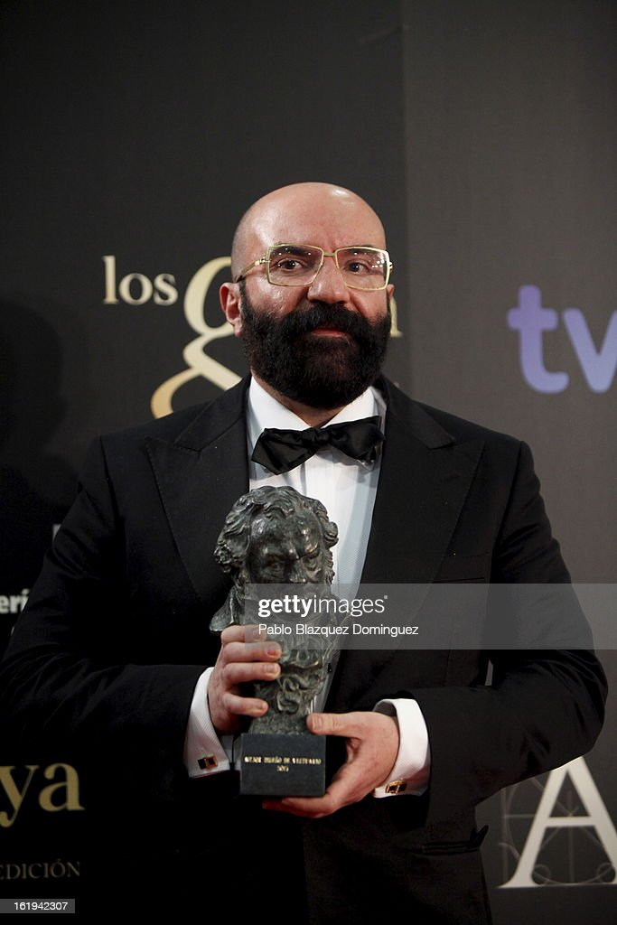Paco Delgado holds his award for Best Costume Desing in the film 'Blancanieves' during the 2013 edition of the 'Goya Cinema Awards' ceremony at Centro de Congresos Principe Felipe on February 17, 2013 in Madrid, Spain.