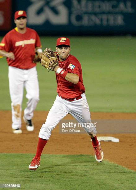 Paco Figueroa of Team Spain throws to first base during game 2 of the Qualifying Round of the 2013 World Baseball Classic at Roger Dean Stadium...