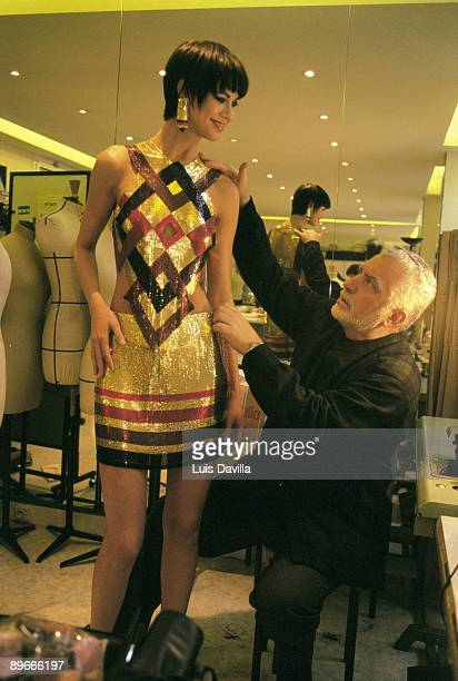 Paco Rabanne at his studio in Paris The fashion designer fixing one of his designs on a model
