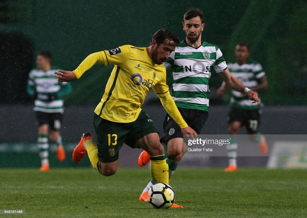 FC Pacos de Ferreira defender Joao Gois from Portugal fights for the ball with Sporting CP midfielder Bruno Fernandes from Portugal during the Primeira Liga match between Sporting CP and FC Pacos de Ferreira at Estadio Jose Alvalade on April 8, 2018 in Lisbon, Portugal.