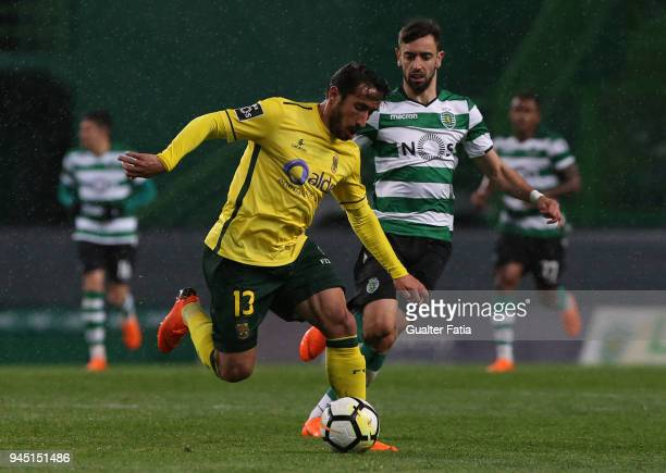 Pacos de Ferreira defender Joao Gois from Portugal fights for the ball with Sporting CP midfielder Bruno Fernandes from Portugal during the Primeira...