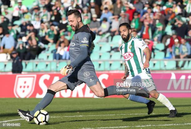 Pacos de Ferreira goalkeeper Rafael Defendi from Brazil with Vitoria Setubal midfielder Joao Costinha from Portugal in action during the Primeira...
