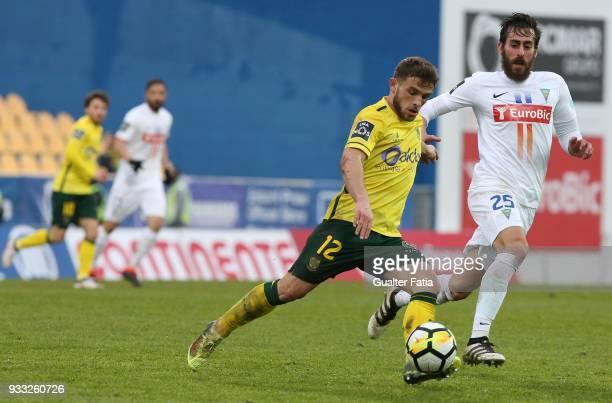 Pacos de Ferreira midfielder Pedrinho from Portugal with GD Estoril Praia midfielder Charis Kyriakou from Cyprus in action during the Primeira Liga...