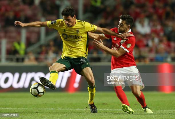 Pacos de Ferreira midfielder Vasco Rocha from Portugal with SL Benfica forward Pizzi from Portugal in action during the Primeira Liga match between...