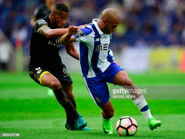 Pacos de Ferreira's Brazilian defender Bruno Santos vies with Porto's Algerian forward Yacine Brahimi during the Portuguese league football match FC...