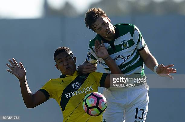 Pacos de Ferreira's Brazilian forward Welthon Sampaio jumps for a ball with Sporting's Uruguayan defender Sebastian Coates during the Portuguese...