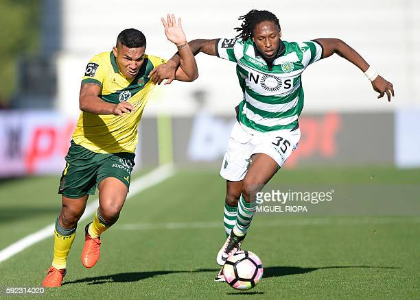 Pacos de Ferreira's Brazilian forward Welthon Sampaio vies with Sporting's defender Ruben Semedo during the Portuguese league football match FC Pacos...