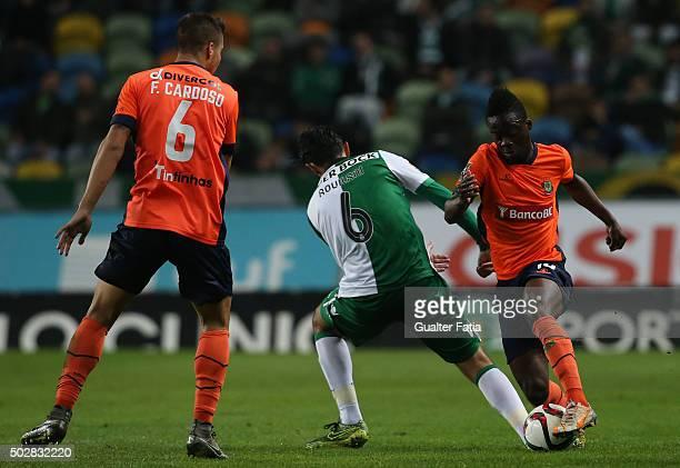Pacos de FerreiraÕs forward Barnes Osei with Sporting CPÕs midfielder Alberto Aquilani in action during the Taca da Liga match between Sporting CP...