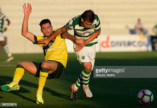 Pacos de Ferreira's forward Ivo Rodrigues vies with Sporting's defender Joao Pereira during the Portuguese league football match FC Pacos de Ferreira...