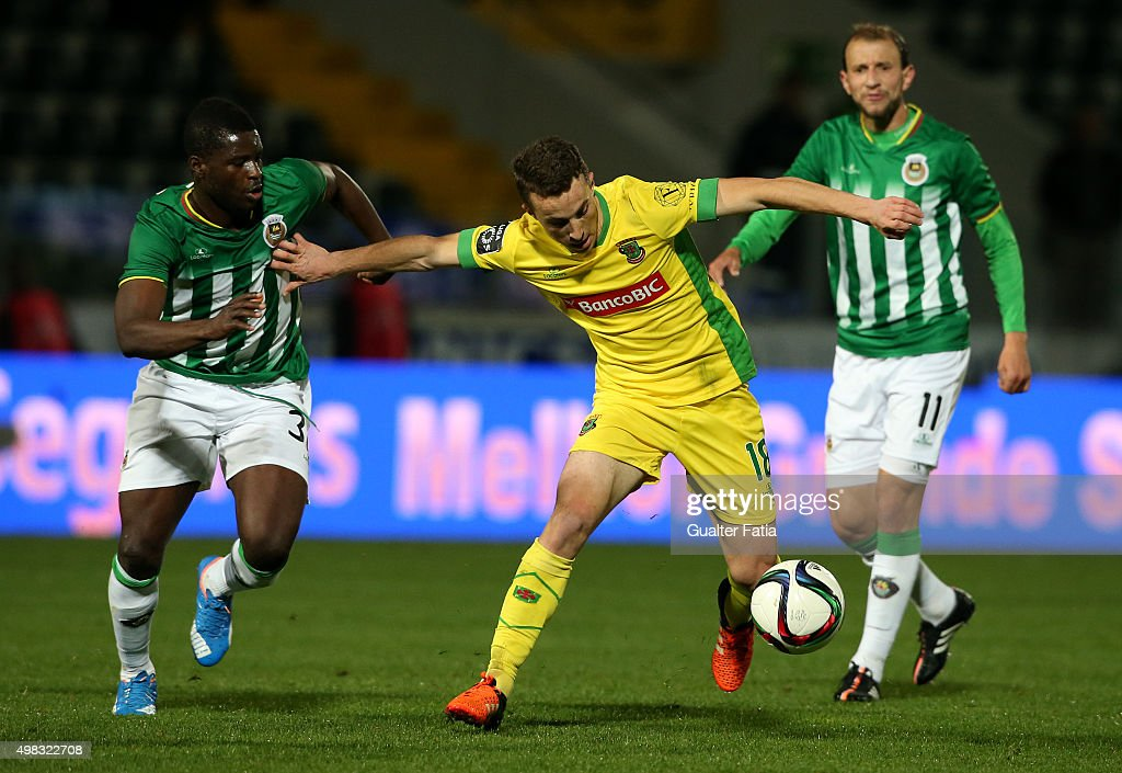 Pacos de Ferreira's midfielder Diogo Jota with Rio Ave FC's midfielder Alhassan Wakaso in action during the Taca de Portugal match between FC Pacos de Ferreira and Rio Ave FC at Estadio da Mata Real on November 22, 2015 in Pacos de Ferreira, Portugal.