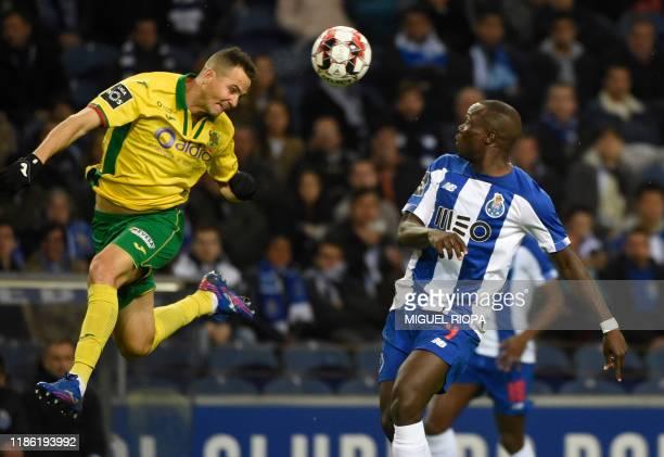 Pacos Ferreira's Brazilian defender Bruno Teles heads the ball beside FC Porto's Cameroonian forward Vincent Aboubakar during the Portuguese league...