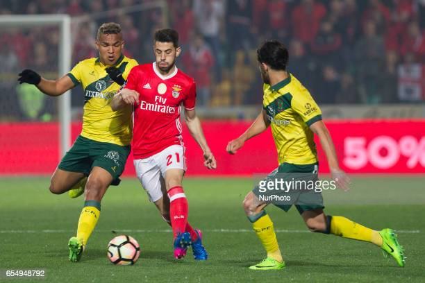 Pacos Ferreira's Brazilian forward Welthon with Benfica's Portuguese midfielder Pizzi during the Premier League 2016/17 match between Pacos Ferreira...