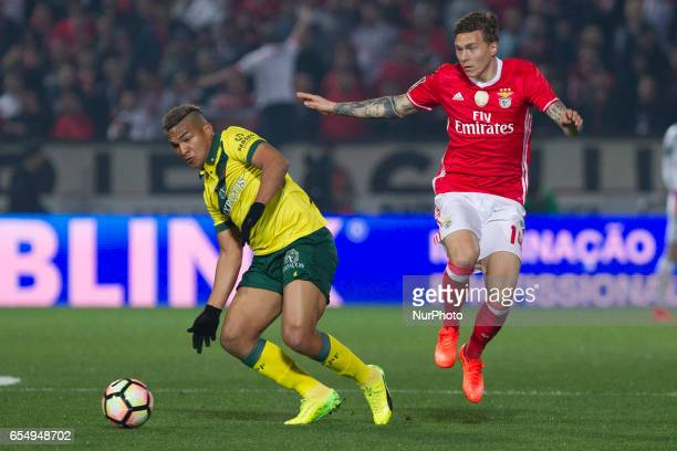 Pacos Ferreira's Brazilian forward Welthon with Benfica's Swedish defender Victor Lindelof during the Premier League 2016/17 match between Pacos...
