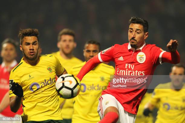 Pacos Ferreira's Brazilian midfielder Luiz Phellype with Benfica's Portuguese defender Andre Almeida during the Premier League 2017/18 match between...