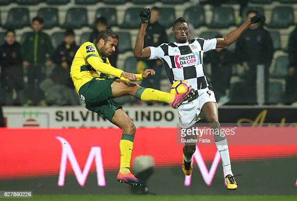 Pacos Ferreira's defender Ricardo from Portugal with Boavista FC's forward Ide Gomes in action during the Primeira Liga match between Pacos de...