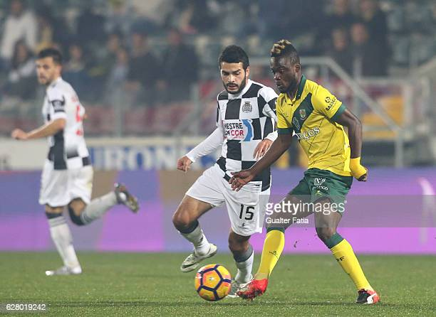 Pacos Ferreira's forward Barnes Osei from Gana with Boavista FC's midfielder Emin Makhmudov in action during the Primeira Liga match between Pacos de...