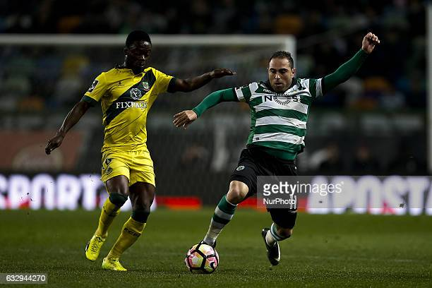 Pacos Ferreira's forward Barnes Osei vies for the ball with Sporting's forward Bruno Cesar during Premier League 2016/17 match between Sporting CP vs...