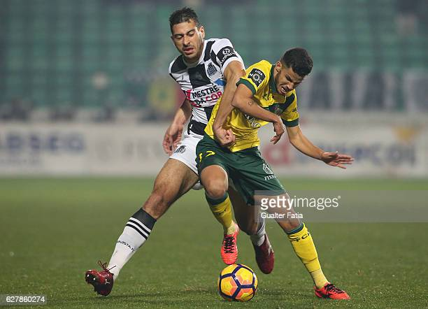 Pacos Ferreira's forward Gleison from Brazil with Boavista FC's defender Lucas in action during the Primeira Liga match between Pacos de Ferreira and...