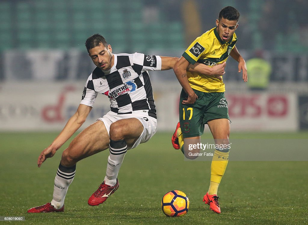 Pacos Ferreira's forward Gleison from Brazil (R) with Boavista FC's defender Lucas (L) in action during the Primeira Liga match between Pacos de Ferreira and Boavista FC at Estadio da Mata Real on December 5, 2016 in Pacos de Ferreira, Portugal.