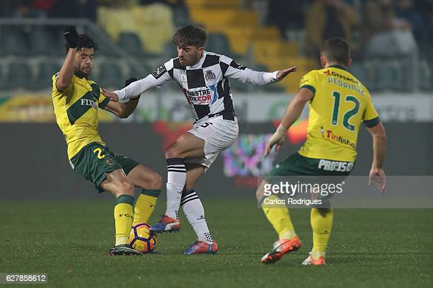 Pacos Ferreira's forward Ivo Rodrigues from Portugal vies with Boavista's forward Iuri Medeiros from Portugal during the match between FC Pacos de...