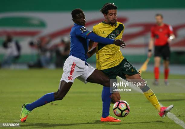 Pacos Ferreira's forward Ivo Rodrigues from Portugal with Belenenses's defender Edgar Ie from Portugal in action during the Primeira Liga match...