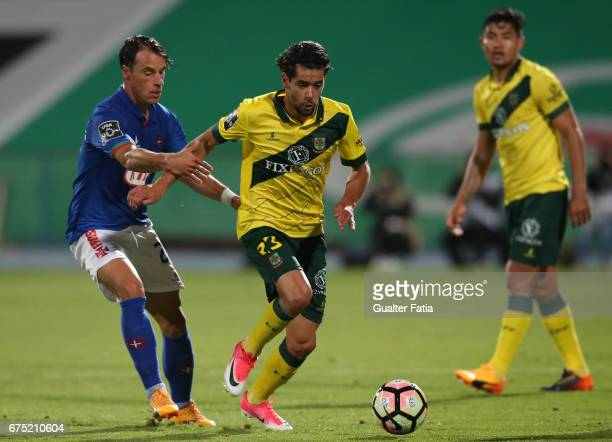 Pacos Ferreira's forward Ivo Rodrigues from Portugal with Belenenses's midfielder Vitor Gomes from Portugal in action during the Primeira Liga match...