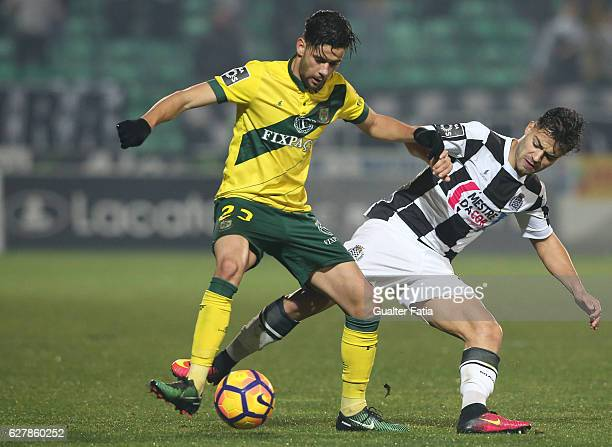 Pacos Ferreira's forward Ivo Rodrigues from Portugal with Boavista FC's midfielder Carraca in action during the Primeira Liga match between Pacos de...