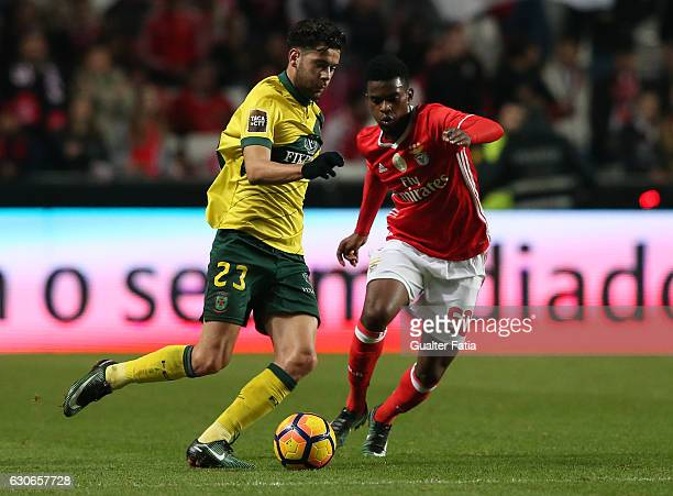 Pacos Ferreira's forward Ivo Rodrigues from Portugal with SL Benfica's defender Nelson Semedo in action during the Primeira Liga match between SL...