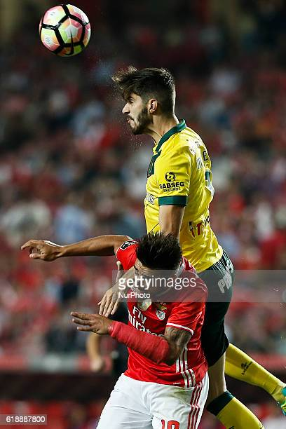 Pacos Ferreira's forward Ivo Rodrigues vies for the ball with Benfica's forward Eduardo Salvio during Premier League 2016/17 match between SL Benfica...