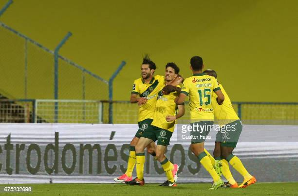 Pacos Ferreira's forward Vasco Rocha from Portugal celebrates with teammates after scoring a goal during the Primeira Liga match between CF Os...
