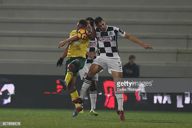 Pacos Ferreira's forward Walton from Brazil vies with Boavista's defender Lucas Tagliapietra from Brazil during the match between FC Pacos de...