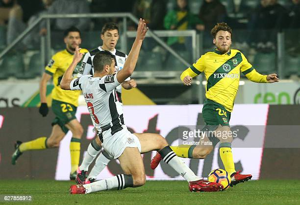 Pacos Ferreira's midfielder Andrezinho from Portugal with Boavista FCÕs defender Lucas in action during the Primeira Liga match between Pacos de...