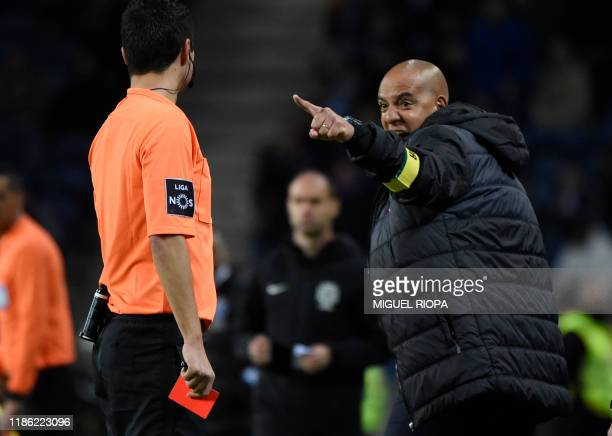 Pacos Ferreira's Portuguese coach Pedro Miguel Marques da Costa Filipe points at Portuguese referee Tiago Martins after being handed a red card...