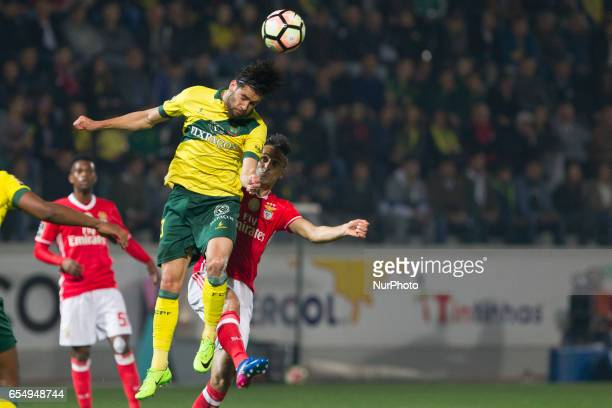 Pacos Ferreira's Portuguese defender Pedro Monteiro with Benfica's Brazilian forward Jonas during the Premier League 2016/17 match between Pacos...