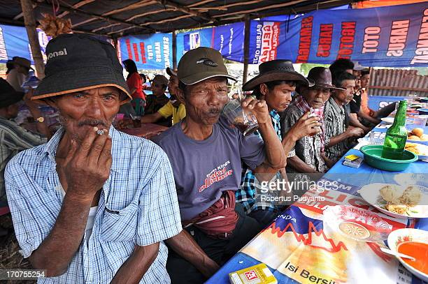 Pacu Jawi in Tanah Datar, Western Sumatra, Indonesia on January 12, 2013 : Retired and active Pacu Jawi jockeys and also cow owner gather at a coffee...