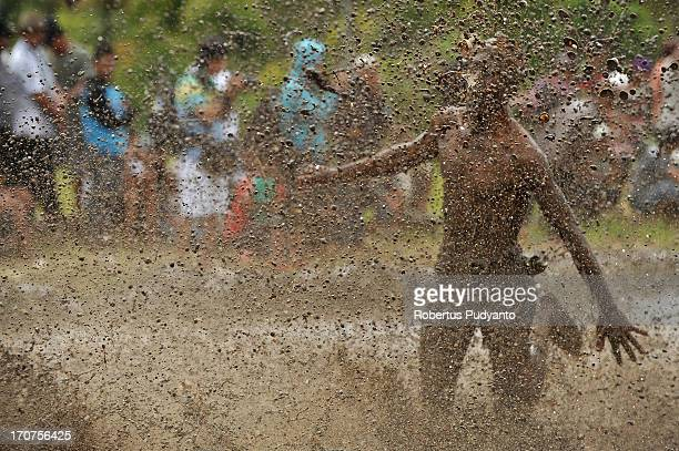 CONTENT] Pacu Jawi in Tanah Datar Western Sumatra Indonesia on January 12 2013 Pacu Jawi jockey mud bath when he fell in the racing The annual Cow...