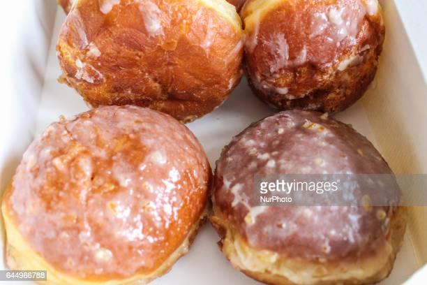Paczki traditional fistsized donut filled with rose marmalade are seen on 23 February 2017 in Gdynia Poland Fat Thursday is a traditional Christian...
