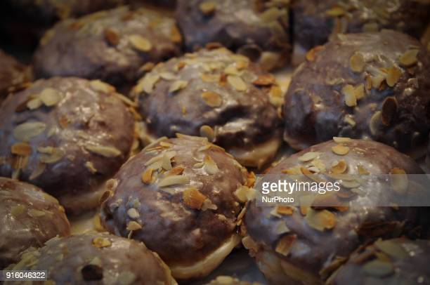 Paczki with almonds or Polish donuts are seen on display at a bakery on Tlusty Czwartek on February 8 2018 Tlusty Czwartek or Fat Thursday is the...