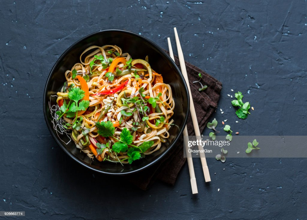 Pad Thai vegetarian vegetables udon noodles in a dark background, top view. Vegetarian food in asian style. Copy space : Stock Photo