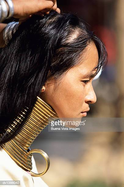 Padaung Woman Having Her Hair Arranged, Mae Hong Son, Thailand