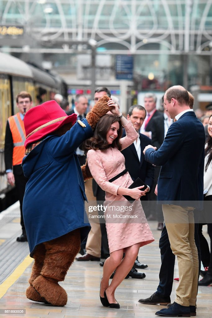 Paddington Bear dances with Catherine, Duchess of Cambridge and Prince William, Duke of Cambridge at the Charities Forum Event on board the Belmond Britigh Pullman train at Paddington Station on October 16, 2017 in London, England.