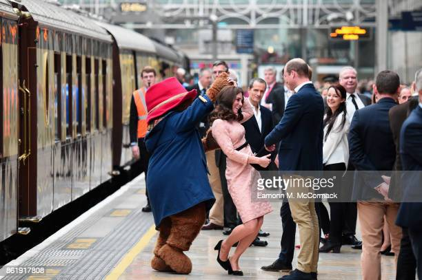 Paddington Bear dances with Catherine Duchess of Cambridge and Prince William Duke of Cambridge at the Charities Forum Event on board the Belmond...