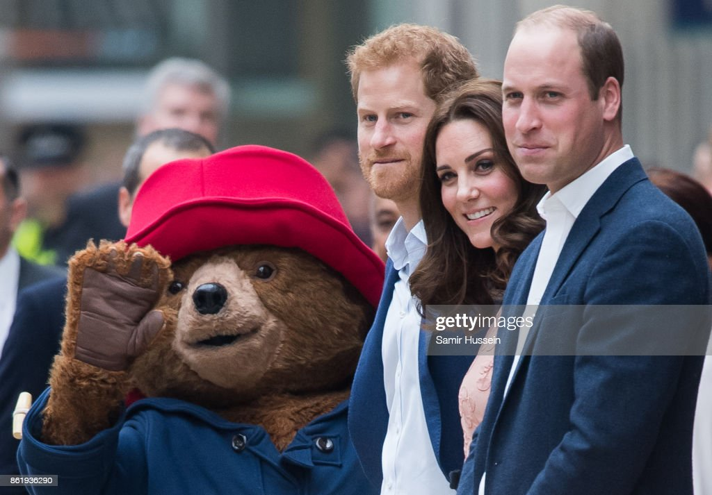 Paddington Bear, Prince Harry, Catherine, Duchess of Cambridge and Prince William, Duke of Cambridge attends the Charities Forum Event on board the Belmond Britigh Pullman train at Paddington Station on October 16, 2017 in London, England.