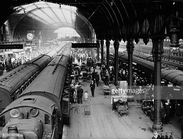 Paddington Station in London in June as holiday crowds board trains for Cornwall Holiday crowds boarding trains for the Cornish Riviera at Paddington...