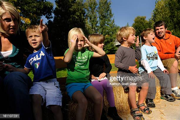 Paddington Station Preschool in Denver hosts a horsedrawn wagon from Happy Trails Horse Drawn Rides complete with bales of hay for its preschoolers...