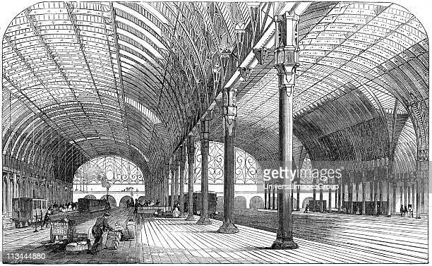 Paddington Station the London terminus of the Great Western Railway 1854 Iron was used in the construction of the roof and the spans supported on...