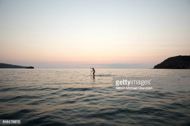 Paddle boarder at sunset in Mexico