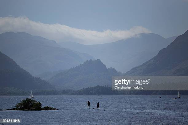 Paddle boarders make their way across Derwent Water on August 17 2016 in Keswick England The Lake District continues to recover after the devastating...