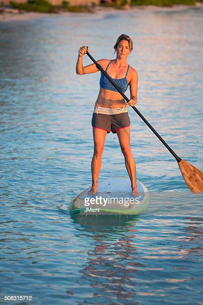 Paddle Boarding Woman on a Calm Ocean Bay